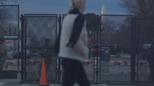 onlookers take pictures of national guard standing guard at a checkpoint at the u.s. capitol on january 17, 2021 in washington, dc. there are 25,000... - focus on background stock videos & royalty-free footage