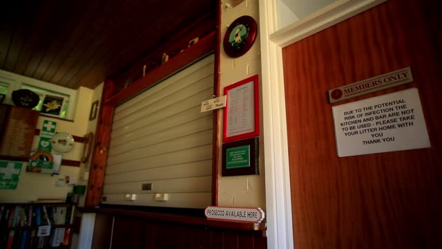 only a ticking clock can be heard in the bar of farnborough bowls club who's members are back on the green despite having to adhere to strict... - clock stock videos & royalty-free footage
