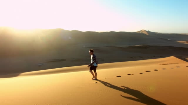 only him and his footprints - namibian desert stock videos and b-roll footage