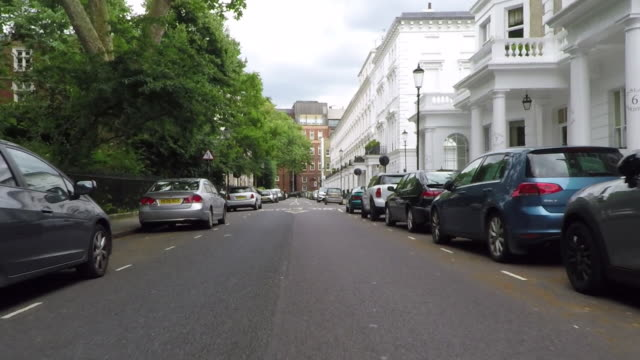 onslow gardens, south kensington. driving pov. - kensington und chelsea stock-videos und b-roll-filmmaterial