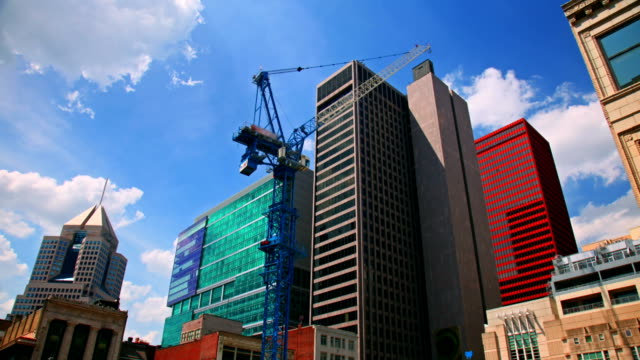 Сonstruction crane moving at downtown background