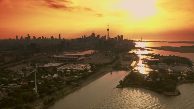 aerial ontario place with toronto skyline in the background at sunrise - ontario canada stock videos & royalty-free footage