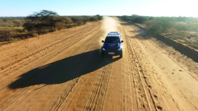 onwards to desert adventure - automobile video stock e b–roll