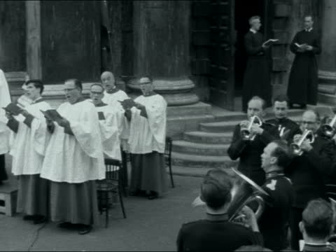 open air service at st martin-in-the-fields; england: london: gv st martin's from trafalgar square salvation army band walk into courtyard woman... - tired stock videos & royalty-free footage