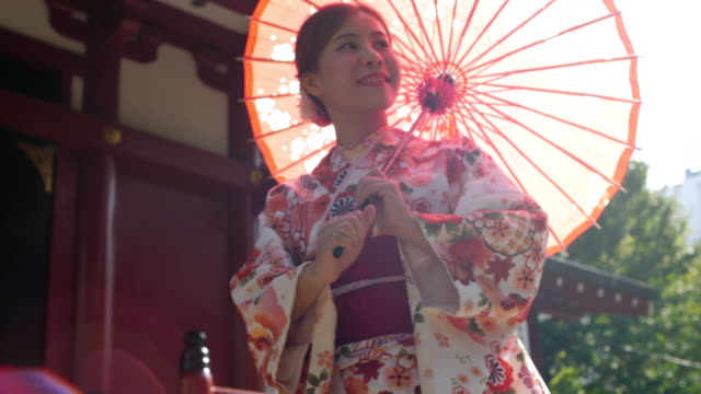 open an umbrella in traditional japanese kimono dress - tradition stock videos & royalty-free footage