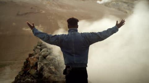 open arms. african ethnicity man enjoying hissing steam vents - 4k resolution stock videos & royalty-free footage