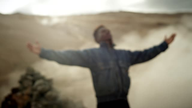 Open arms. African ethnicity man enjoying hissing steam vents
