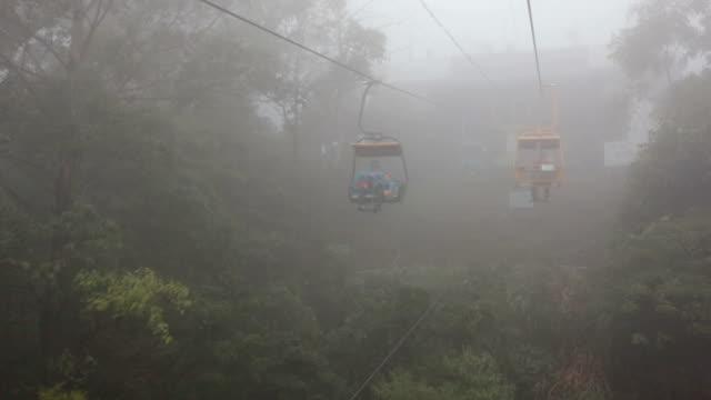 ws open cable sightseeing ending at rainy day - inquadratura dalla sciovia video stock e b–roll
