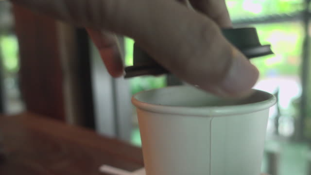 open cap hot coffee in disposable cup dolly shot - canteen stock videos & royalty-free footage