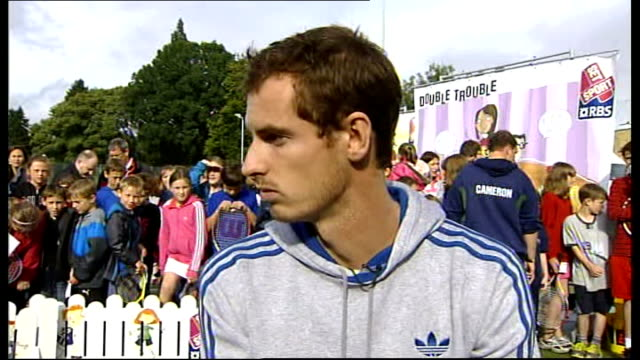 open champion andy murray receives hero's welcome in home town dunblane; andy murray interview sot - ダンブレーン点の映像素材/bロール