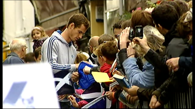 open champion andy murray receives hero's welcome in home town dunblane; scotland: dunblane: ext andy murray signing autographs 'andy you're epic'... - gold medal stock videos & royalty-free footage