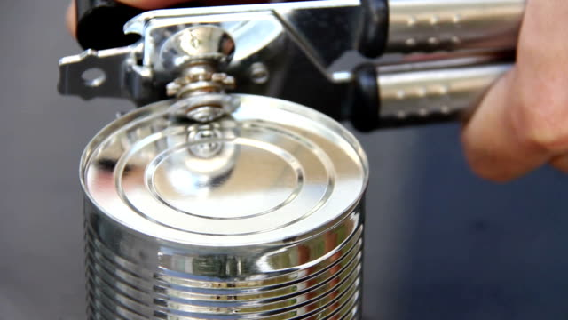 open condensed milk can by canning tool - condensed milk stock videos & royalty-free footage