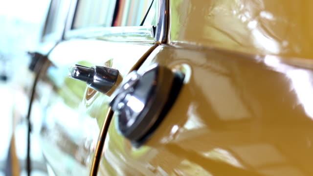 open door of vintage yellow car