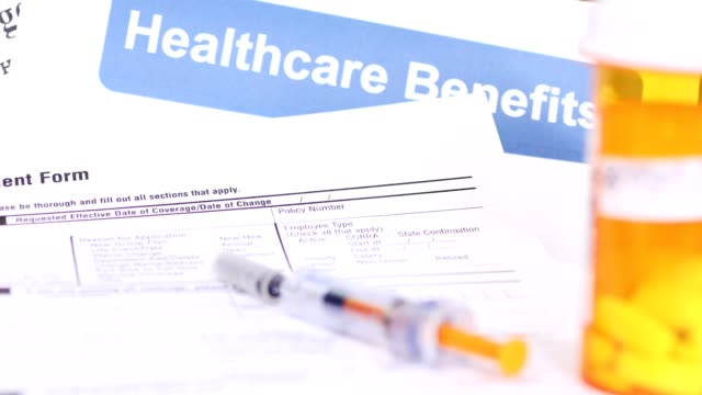 open enrollment healthcare benefit forms. - medical insurance stock videos & royalty-free footage