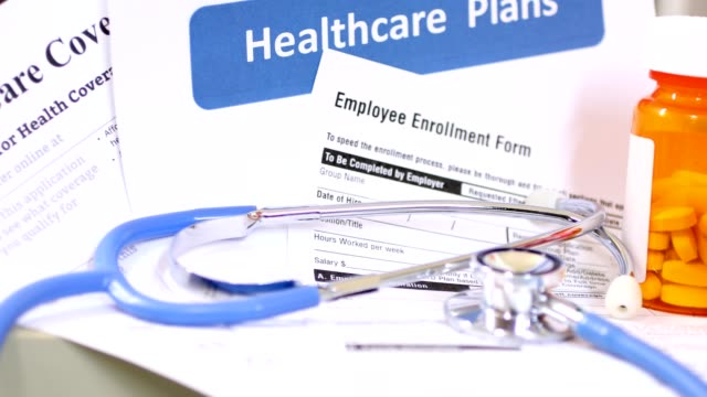 open enrollment healthcare benefit forms. - medicare stock videos & royalty-free footage