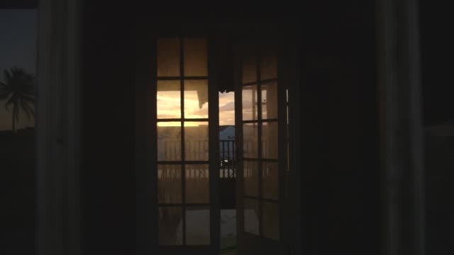 open french doors lead to a view of a building - absence stock videos & royalty-free footage