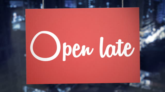 open late sign hanging from ropes. luma matte included so you can put your own background. - urgency stock videos & royalty-free footage