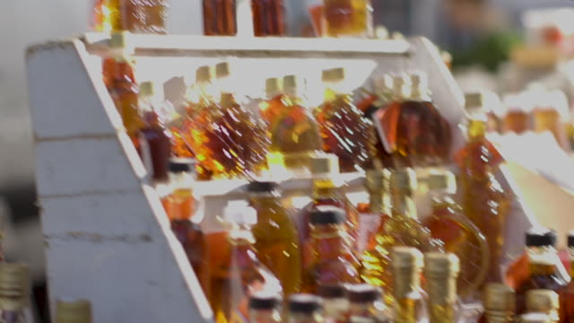 open market - maple syrup on display - maple syrup stock videos & royalty-free footage