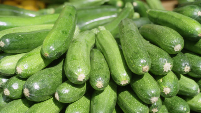 open market - stacked zucchini on display - courgette stock videos and b-roll footage