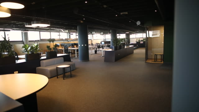 open plan office with work stations and computers. modern office interior with desks and chairs, spacious work environment - no people stock videos & royalty-free footage