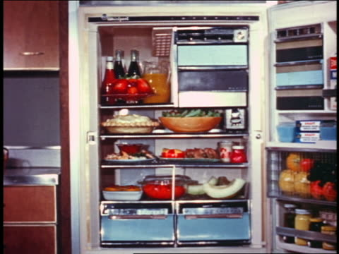 1958 open refrigerator filled with food - 1958 stock videos & royalty-free footage
