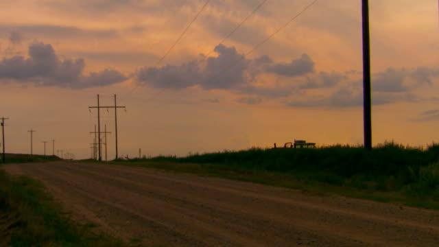 Open road at sunset, tilt down
