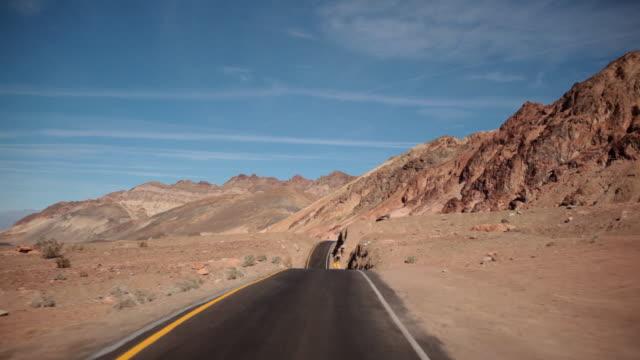 open road pov  - death valley stock-videos und b-roll-filmmaterial