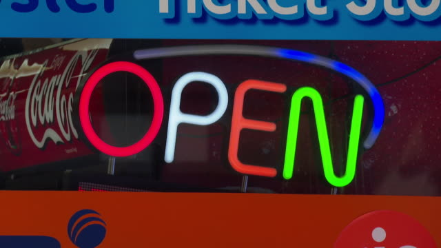open sign flashing in shop window as shops have reopened after coronavirus lockdown - shop window stock videos & royalty-free footage