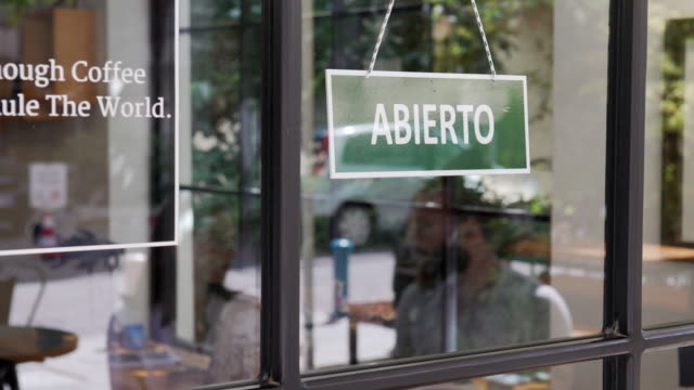abierto - open sign in spanish language - window display stock videos & royalty-free footage
