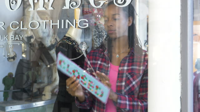 open sign in vintage clothes shop window - shop sign stock videos and b-roll footage