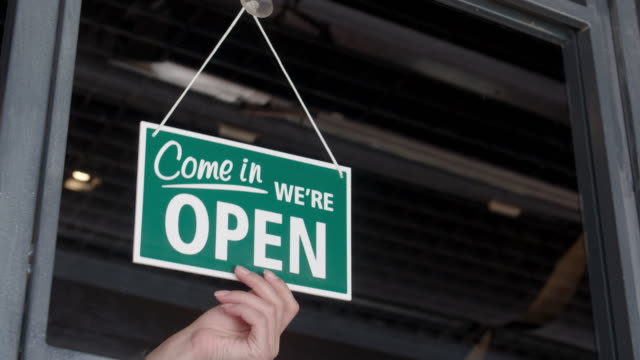 open sign on the shop's window - shop sign stock videos & royalty-free footage