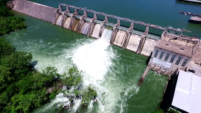 open the flood gates colorado river dam aerial view austin texas - levee stock videos & royalty-free footage