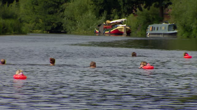open water swimmers in river avon, somerset, which has seen a surge in popularity as coronavirus lockdown restrictions ease - river stock videos & royalty-free footage