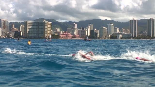 open water swimming race off waikiki beach hawaii leaders underwater diamond head - salmini stock videos & royalty-free footage
