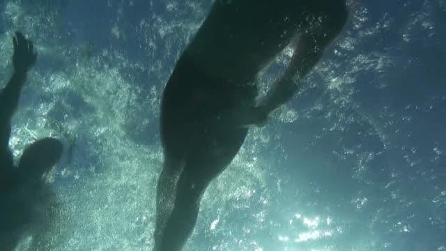 Open water swimming race off Waikiki Beach Hawaii leaders underwater
