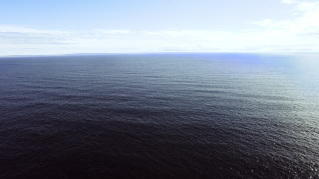 open waters with distant island - atlantic ocean stock videos and b-roll footage