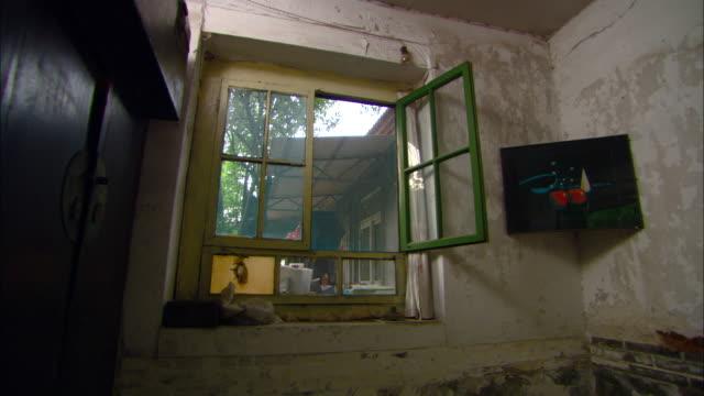 MS Open window in run-down home, Jinan, Shandong, China