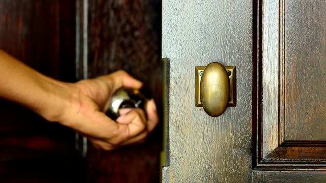open wooden modern door with one hand - closing stock videos & royalty-free footage