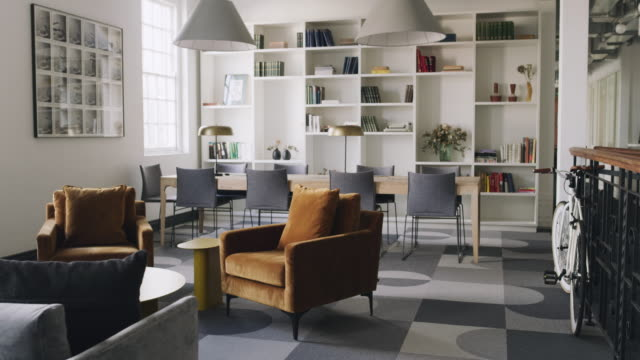 open workspaces with creative furnishings encourage productivity - living room stock videos & royalty-free footage