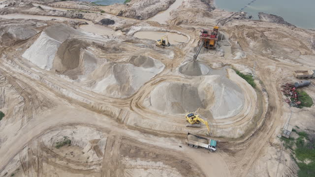 opencast mining quarry with lots of machinery at work - crane construction machinery stock videos & royalty-free footage