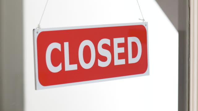 open/closed business sign behind glass. - vanguardians stock videos & royalty-free footage