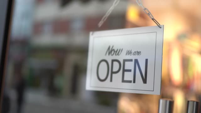 opened sign seen through glass door at store - store sign stock videos & royalty-free footage