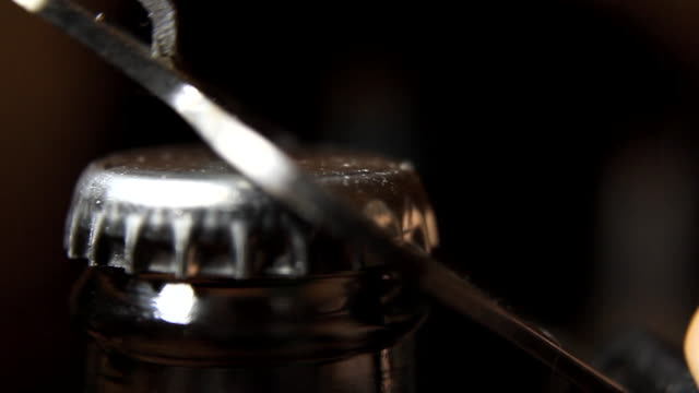 Opening a Beer Bottle, Close Up