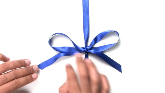 opening a blue bow - tied bow stock videos & royalty-free footage
