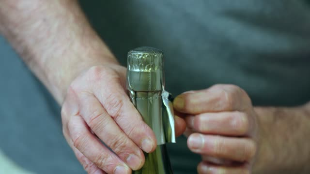 opening a bottle of white wine. - annick vanderschelden stock videos & royalty-free footage