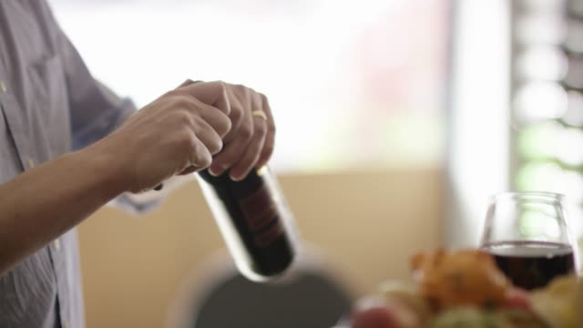 Opening a bottle of wine in slow motion
