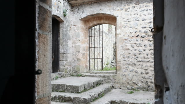 opening a door in an old monastery - gate stock videos & royalty-free footage