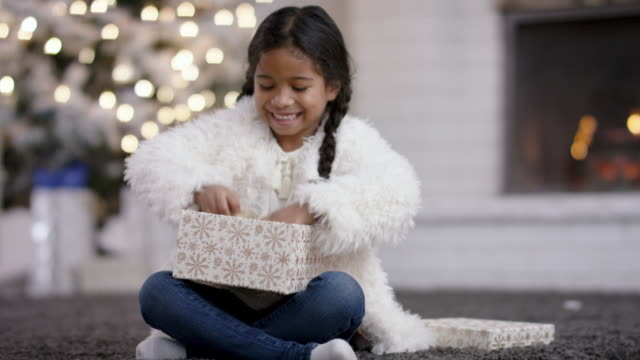 opening a gift - christmas gift stock videos & royalty-free footage
