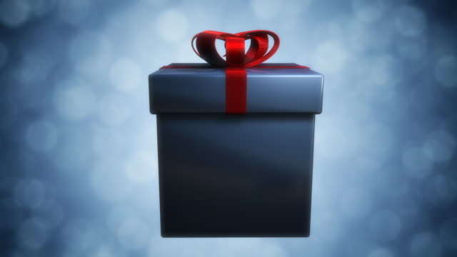 opening a present transition - wrapping paper stock videos & royalty-free footage