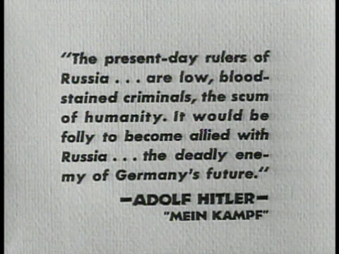'MEIN KAMPF' QUOTE CU Opening Adolf Hitler's Mein Kampf book cover to first page CU Quote 'The presentday rulers of Russia low bloodstained criminals...